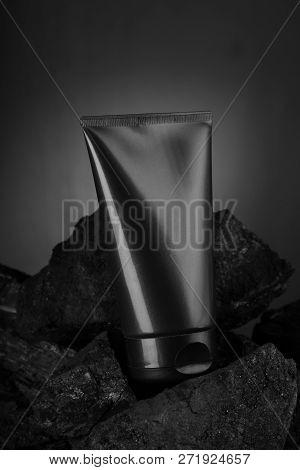 Black Carbon Charcoal Facewash For Mockup On Coal Background