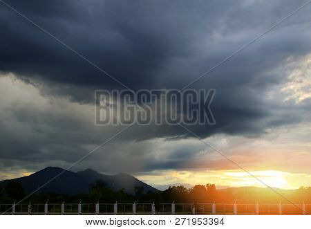 Rainy Storm Season / It's Raining On Hill And Storm Clouds Sunset