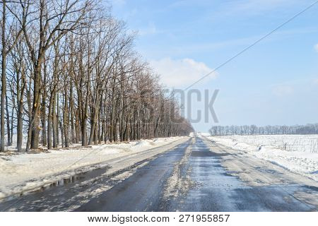 Melting Snow Outside Of The City On The Country Road. Weather Forecast For Early Spring. Melting Sno