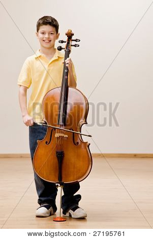 Confident musician standing with cello