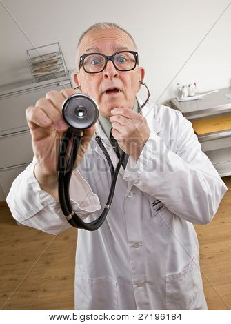 Surprised doctor in lab coat using stethoscope during checkup
