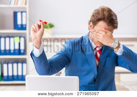 Businessman throwing dart in business concept