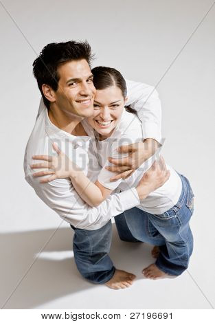 Happy barefoot couple hugging