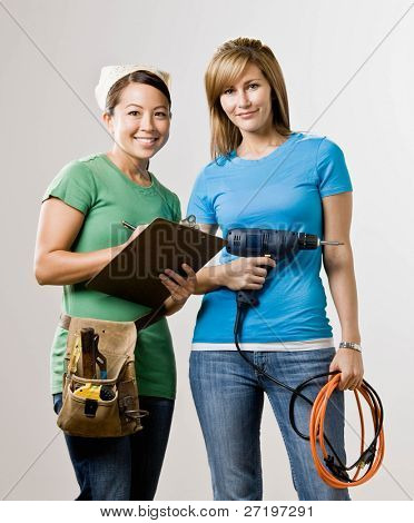 Self-sufficient friends with clipboard, drill and tool belt