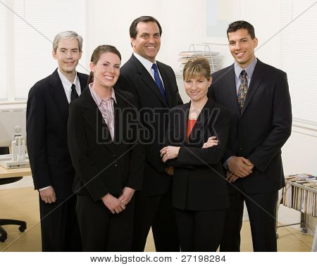 Group of co-workers posing in office