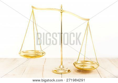 Golden Brass Balance Scale On Wooden Desk Background. Weight Balance Or Imbalance, Symbol Of Law Jus