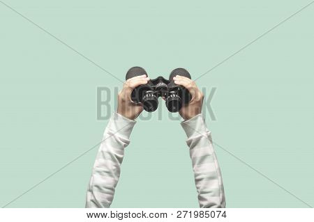 Woman With Binoculars On Green Background, Looking Through Binoculars, Journey, Find And Search Conc