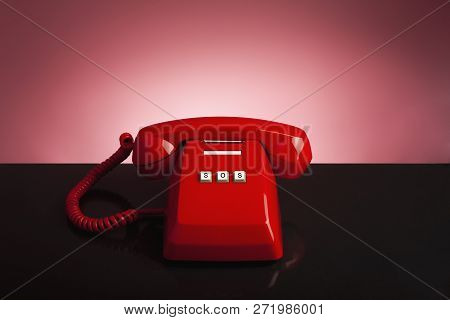 Emergency Call 911 On The Telephone, Red Old Vintage Telephone On Black Background And Desk, Emergen
