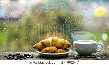 Coffee Time On Rainy Day. Fresh Brewed Coffee In White Cup Or Mug On Windowsill. Wet Glass Window An