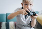 Little boy playing video games poster