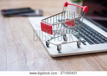 Shopping Cart On Laptop At Home Office. Business, E-business, Technology, E-commerce, Digital Bankin
