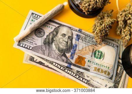 Cannabis In Economics. Sativa Thc Cbd. Money Weed. Joint Weed. Marijuana Weed Bud And Grinder.