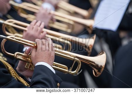 Musicians Are Playing On Trumpets