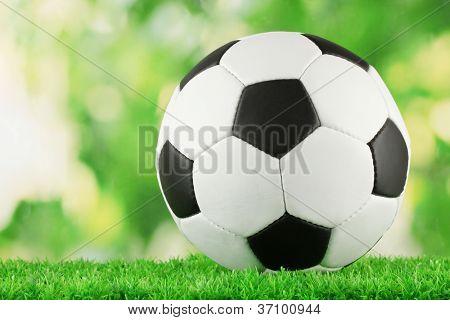 football ball on green grass