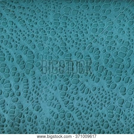 Texture Of Turquoise Openwork Fabric. Detailed Shot Of A Beautiful Fabric. Multitask Background. Vie