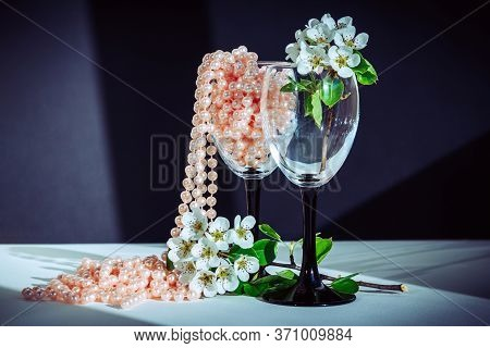 Beautiful Blooming Pear Tree Branch With White Flowers In Wine Glass With Pink Pearl Beads