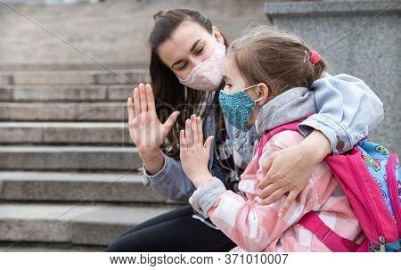 Back To School . Coronavirus Pandemic Children Go To School In Masks