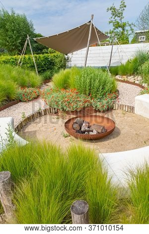 Garden Design With Sunshade, Metal Fireplace, Marram Grass And Natural Terrace Inspired By The Beach