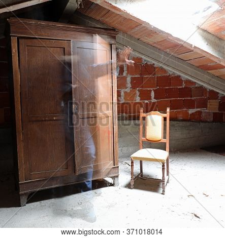Ghostly Human Presence That Comes Out Of The Closet In A Dusty Attic Of The Abandoned House