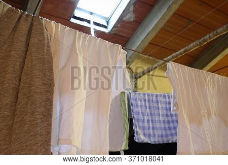 Tablecloths And Tea Towels To Hang In The Attic Of The House After Washing