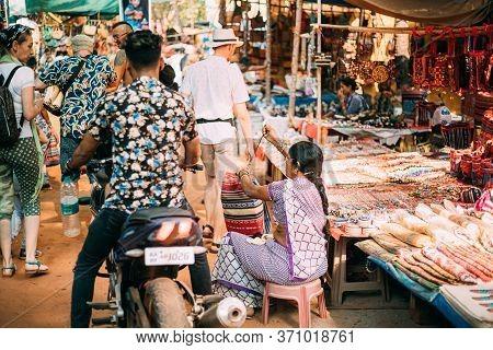 Anjuna, Goa, India - February 19, 2020: Woman Sews A Bag. Seller Sells Indian Traditional Hand-sewn