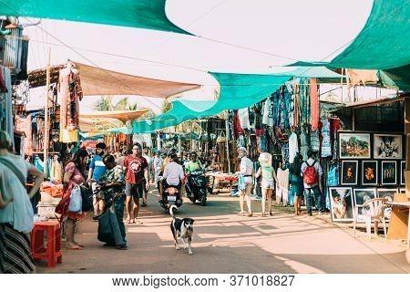 Anjuna, Goa, India - February 19, 2020: People Tourists Walking Across The Anjuna Market.