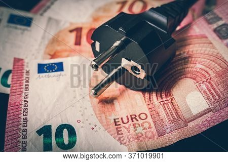 Electric Power Plug And European Money On Background - Expensive Electricity Consumption Concept - R