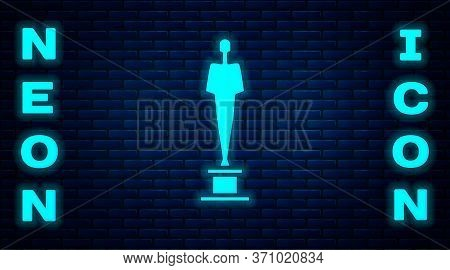Glowing Neon Movie Trophy Icon Isolated On Brick Wall Background. Academy Award Icon. Films And Cine