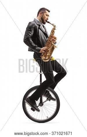 Man riding a unicycle and playing a saxophone isolated on white background