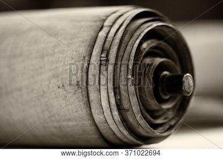 Old Torah Scroll Book Close Up Detail. Torah Jewish People. Shallow Depth Of Field