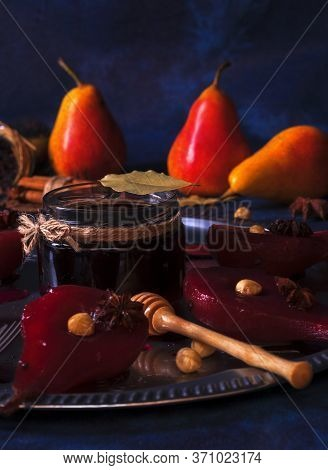 Hibiscus Poached Pears, Sweet Fruit Dessert. Silver Tray With Pears, Embellished With Hazelnuts, Bay