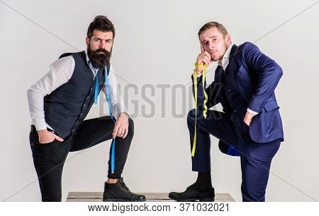 Teamwork Concept. Man With Beard In Waistcoat And Young Tailor