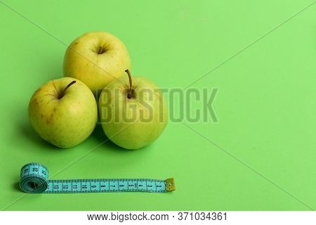 Healthy Diet And Low Calorie Food Concept. Apples Near Tape