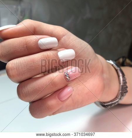 Woman With Flesh-colored Manicure With Design, Close Up