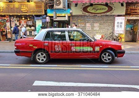 Hong Kong, China - October 6, 2018: Iconic Transportation Vehicle In Hong Kong Is Red Urban Taxi Cab