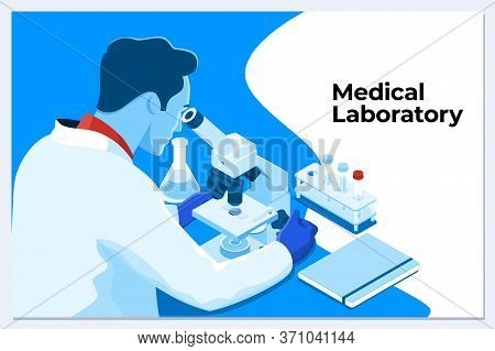 Young Male Scientist Looking Through A Microscope In A Laboratory Doing Research, Microbiological An