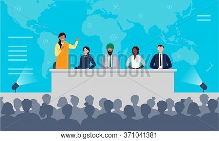 International Press Conference Concept. A Multiethnic Group Of People Is Sitting At The Desk On Stag
