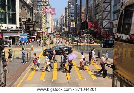 Hong Kong, China - October 7, 2018: Busy City People Crowd In Motion On Zebra Crossing Street