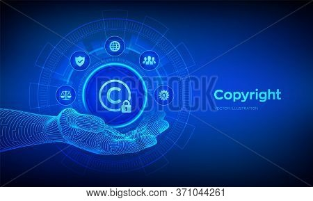 Copyright Icon In Robotic Hand. Patents And Intellectual Property Protection Law And Rights. Protect