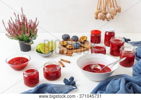 Autumn And Fall Seasonal Kitchen Work, Plum Compote Preserving, Plum Jam Production. Porcelain Bowl