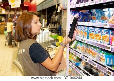 Bordeaux , Aquitaine / France - 04 16 2020 : Woman Working In Supermarket Hyper U Fills Shelves With