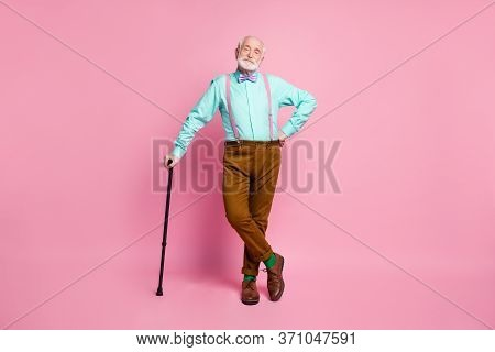 Full Length Photo Of Attractive Grandpa Good Mood Stand Confident Lean Walking Stick Wear Mint Shirt