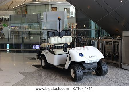 Hong Kong, China - October 7, 2018: White Electric Utility Golf Cart Or Buggy Car For People Transpo