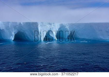 Fog Forming Around An Iceberg In Antarctica.