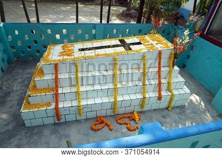 KUMROKHALI, INDIA - FEBRUARY 23, 2020: The tomb of a Croatian missionary, Jesuit father Ante Gabric, decorated on the occasion of his 105th birthday in Kumrokhali, West Bengal, India