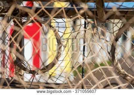 Semi-abstract detail of the colourful lobster barns of Prince Edward Island, Canada, as seen through stached lobster pots.