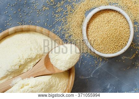 Bowl Of Raw Amaranth Flour With A Spoon And Bowl Of Amaranth Seeds On A Grey Table Top View