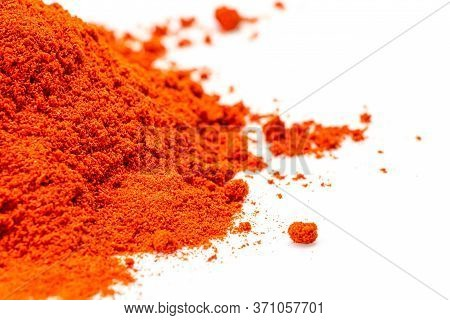 Pile Of Red Paprika Powder Isolated On White Background, Top View
