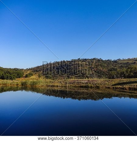 Beautiful Reflection Of A Mountain In A Nearby Lake Near Middelburg In The Mpumulanga Province Of So