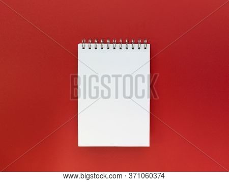Blank Sheet Of Notebook Red Background. Educational Concept. Flat Lay With Copy Space. Stock Photo.